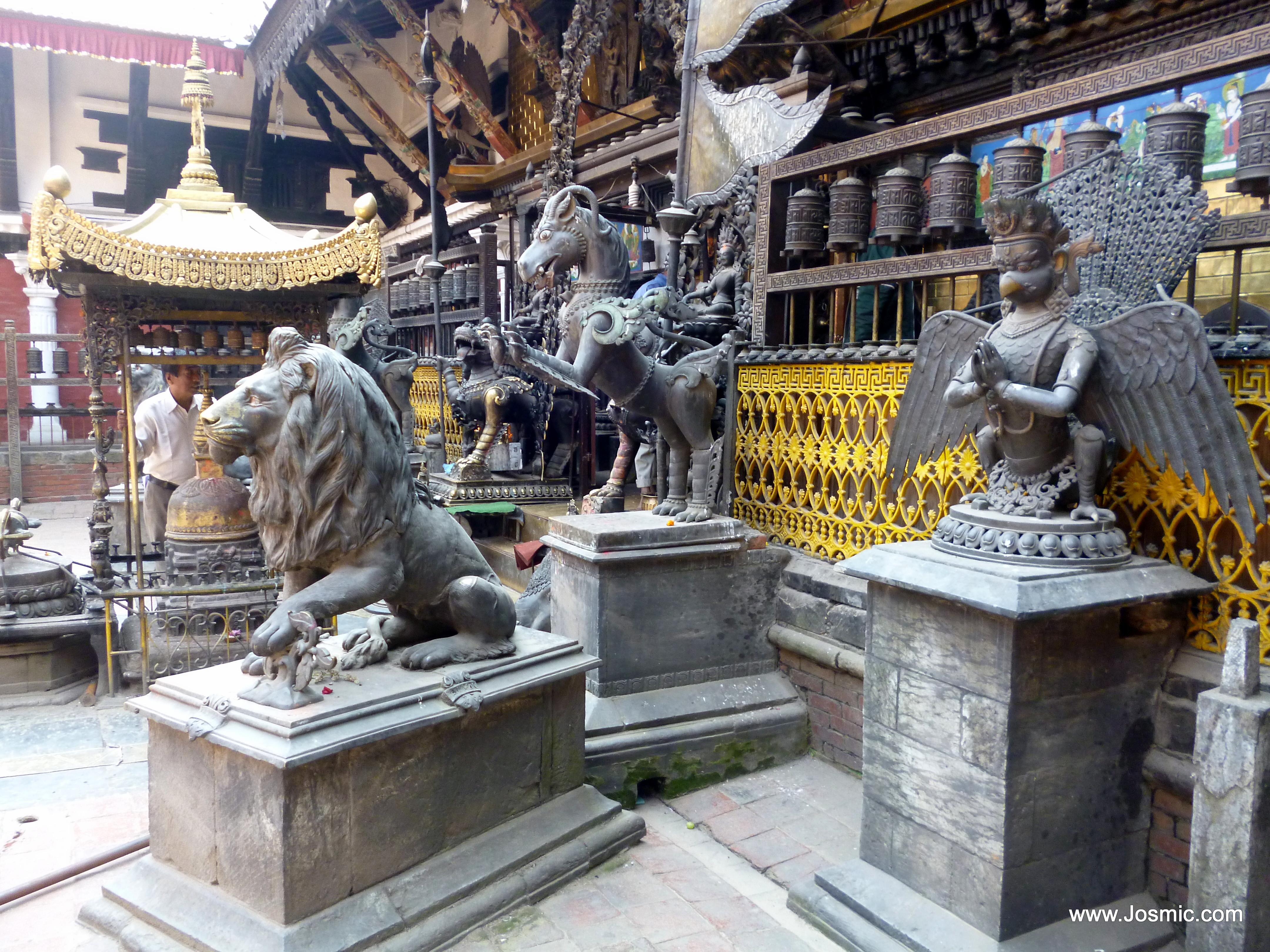 Statues and prayer wheels at Rudravarna Mahavihar